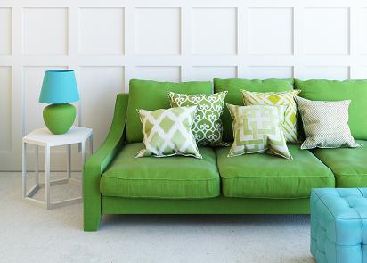 green sofa with cushions