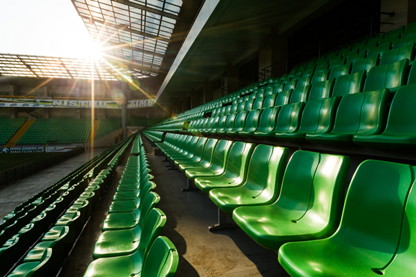 Green sports stadium chairs in rows, representing Angelfish Fieldwork's ethnographic market research case study